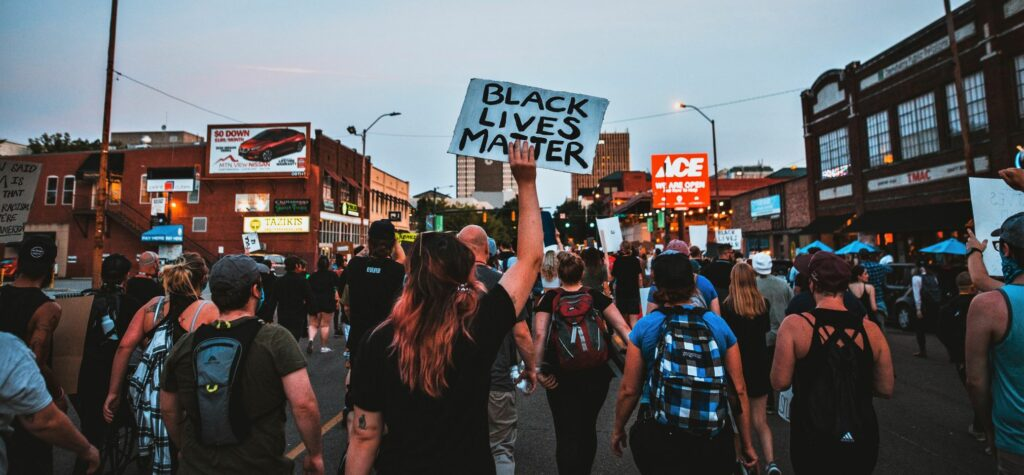 Black Lives Matter Protesters walking down the street in a line